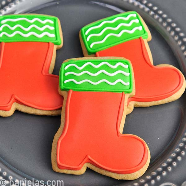 Christmas boots cookies decorated with red and green icing.