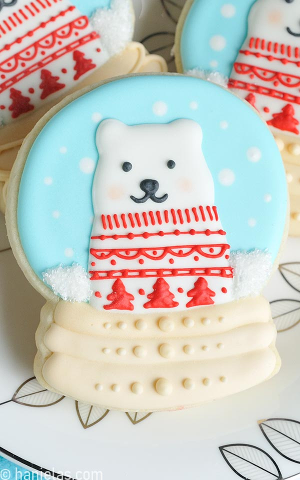 Snow globe cookies decorated with royal icing.