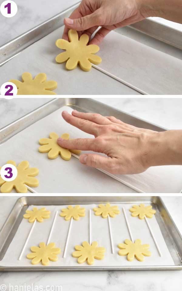 Pressing cookie onto a lollipop stick.