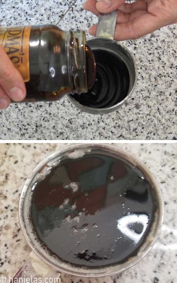 Pouring molasses into a cup measure.