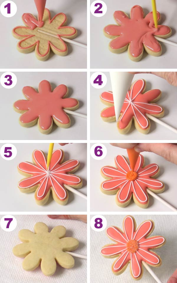 Flower cookies being flooded with royal icing.