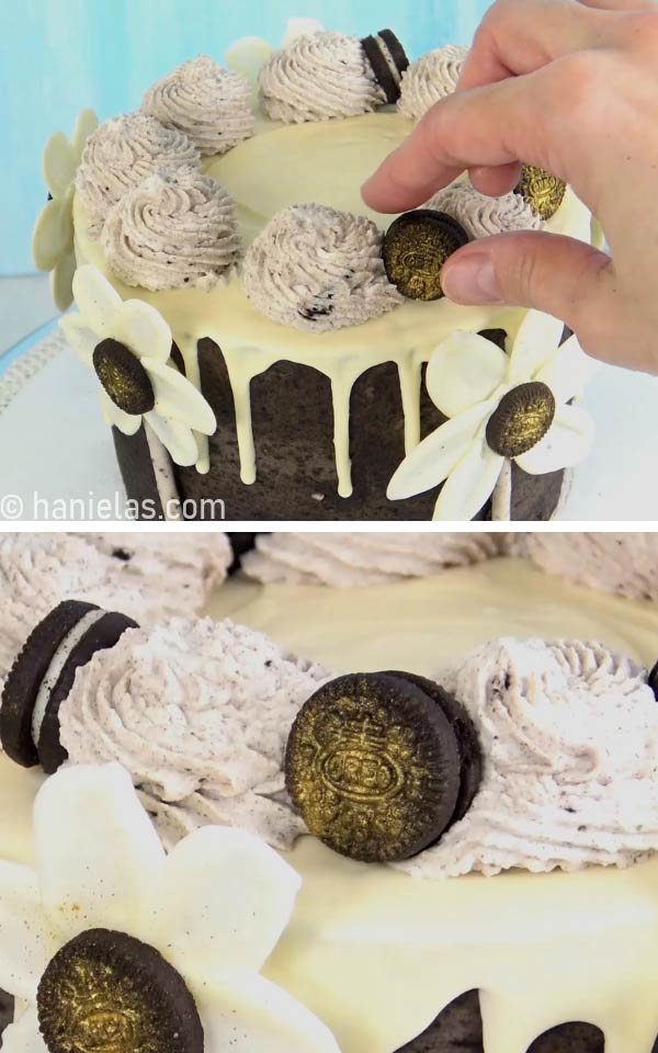 Fingers holding a mini oreo cookie and placing it onto the cake.