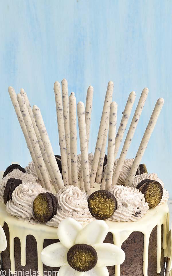Close up of pocky sticks cake topper.