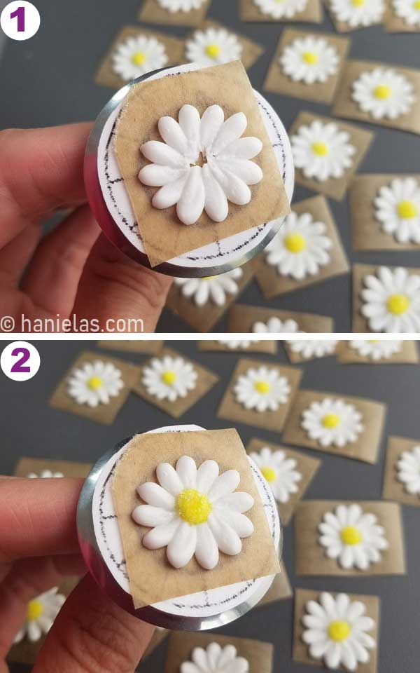 Piped white daisy petals on a flower nail.