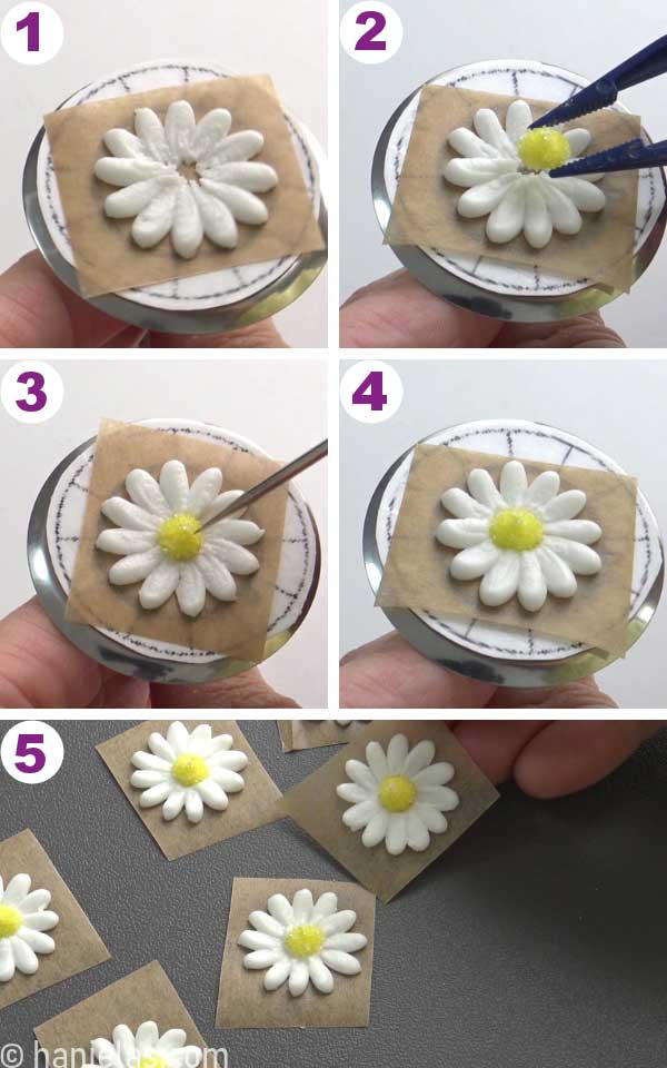 White flower petals piped onto a flower nail, tweezers attaching yellow flower center in the middle of the white flower.