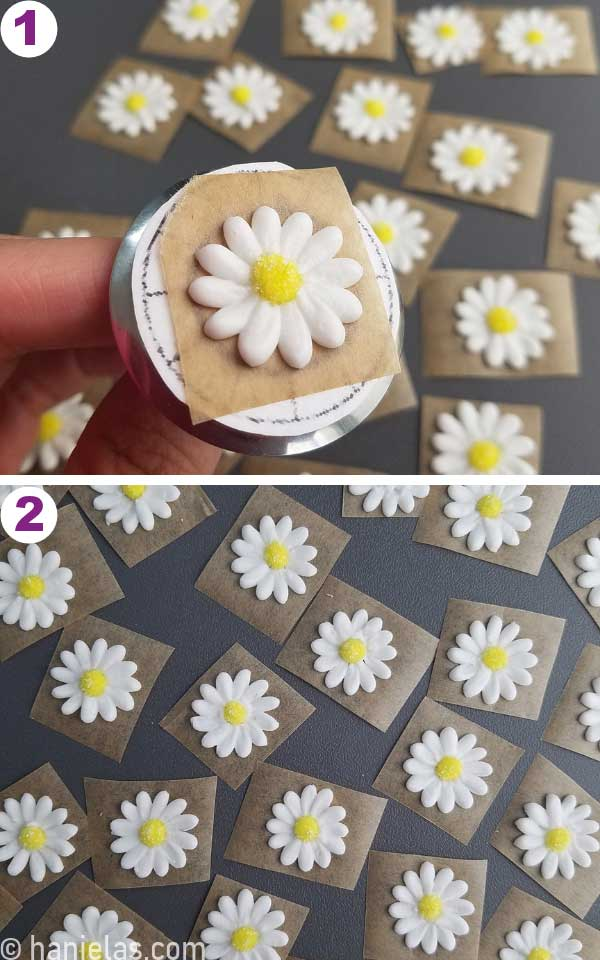Hand holding a flower nail with a piped white daisy royal icing flower.