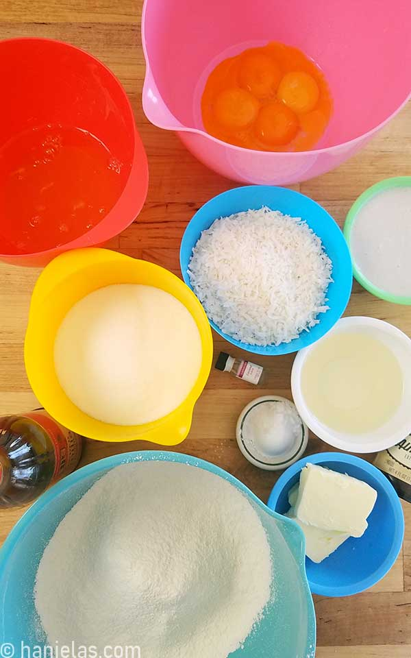Ingredients for a cake in bowls, on a counter.