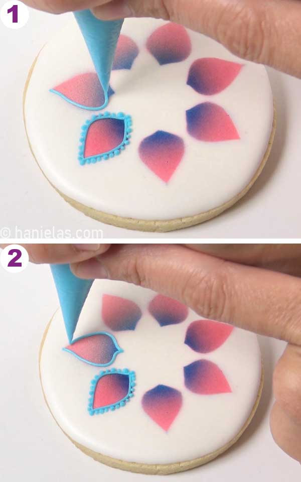 Piping dots onto a cookie.