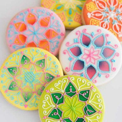 Decorated Mandala Cookies on white background.