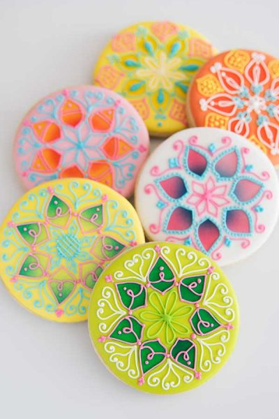 Decorated Mandala Cookies on white background.