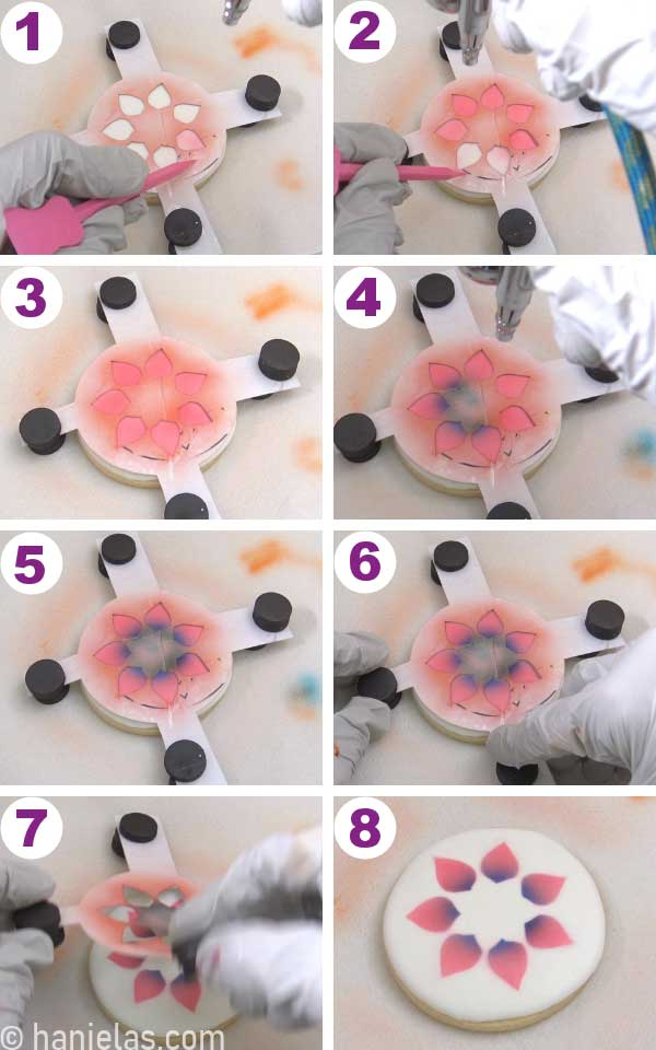 Airbrushing round cookies with pink and blue airbrush colors.