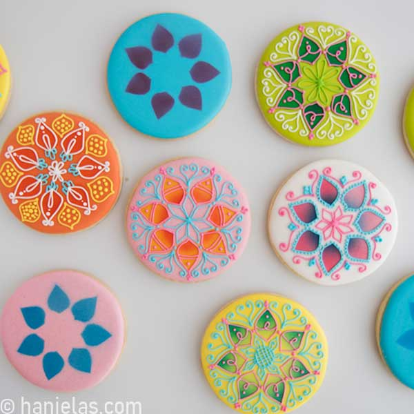 Cookies decorated with royal icing on a white background.