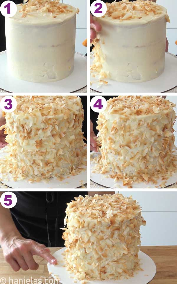 Hand pressing toasted coconut onto a cake.