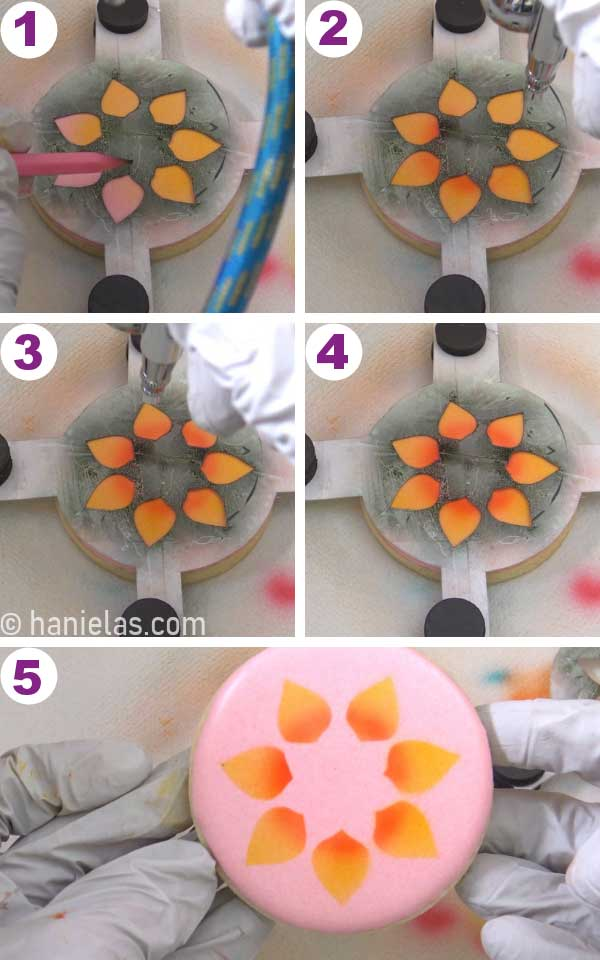Airbrushing pink cookie with yellow and orange colors.