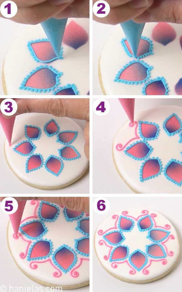 Piping pink swirls, and blue dots onto a white cookie.