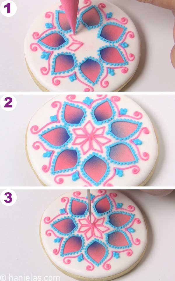 Piping kite outlines onto the white cookie.