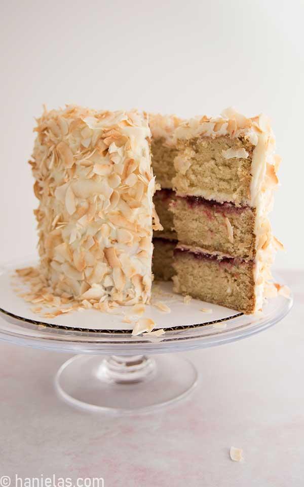 Cut cake on a glass cake stand.