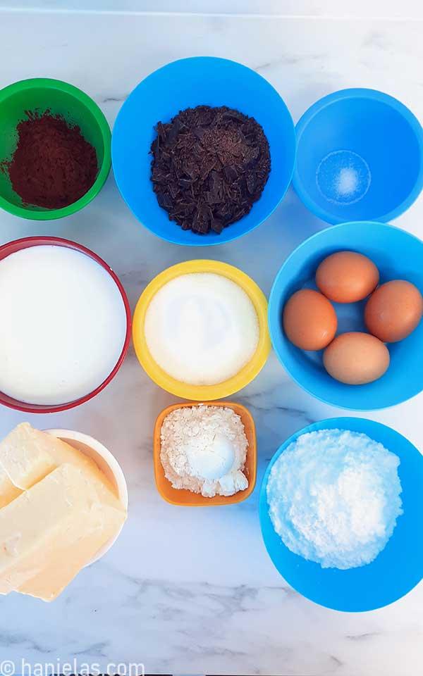 Buttercream ingredients in bowls.