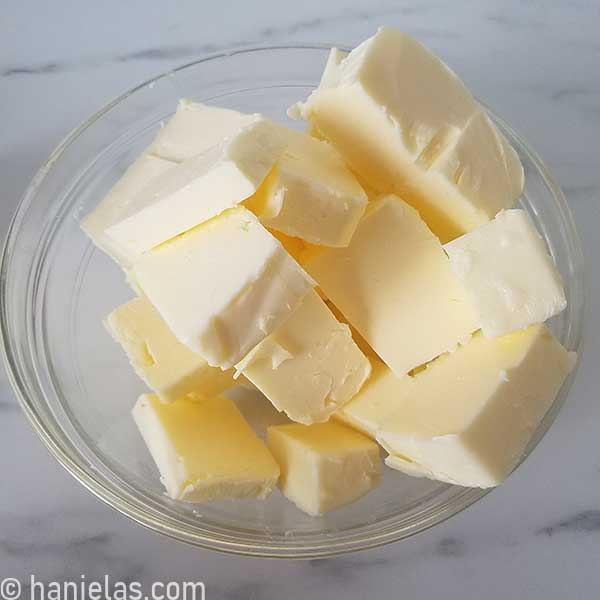 Chunks of butter in a glass bowl.