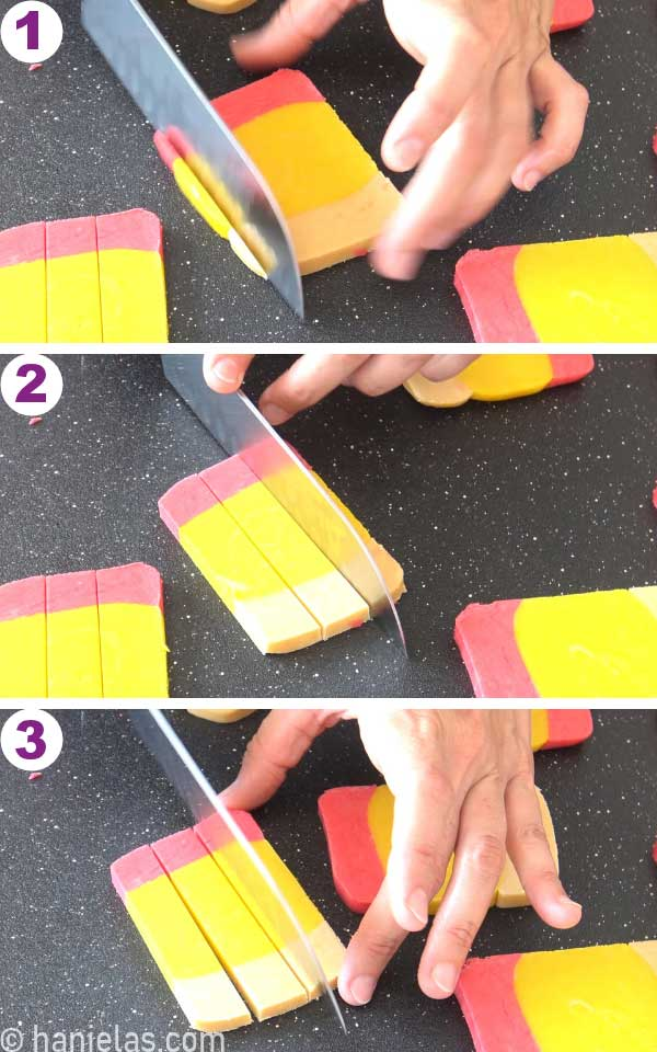 Slicing a piece of colored cookie dough slice into three strips.