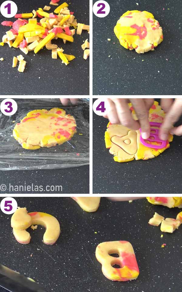 Rolling out marbled cookie dough and cutting out letter cookies.