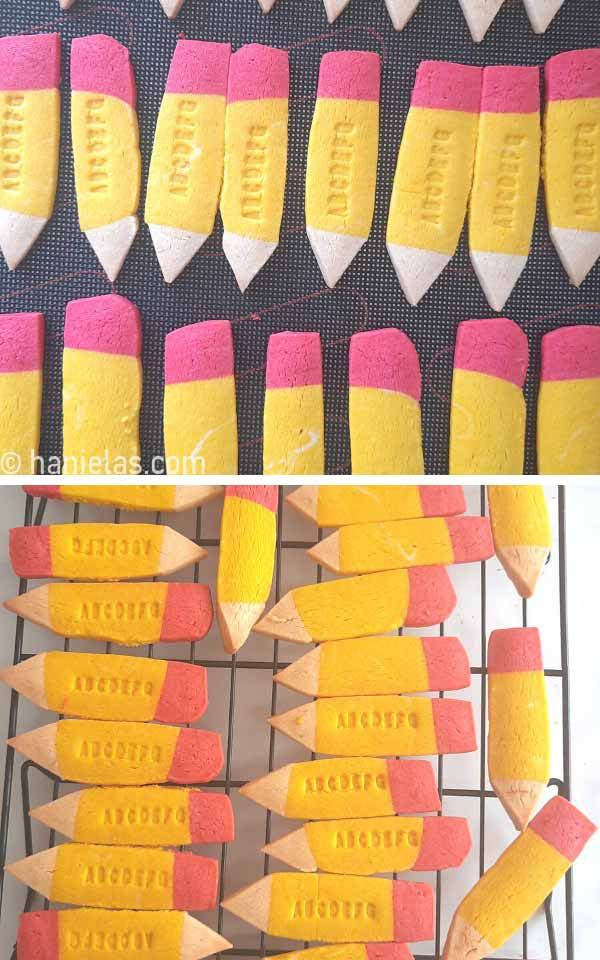 Baked cookies shaped like pencils on a cooling rack.