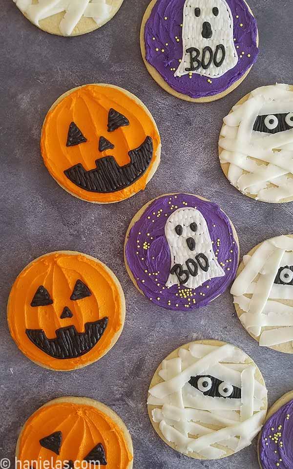 Halloween decorated round cookies on a dark background.